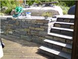 Prof Normal15 - 30 cm deep and steps with slate capping stones.