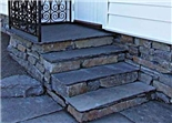 Steps built with Prof Normal topped off with slate capping stones.